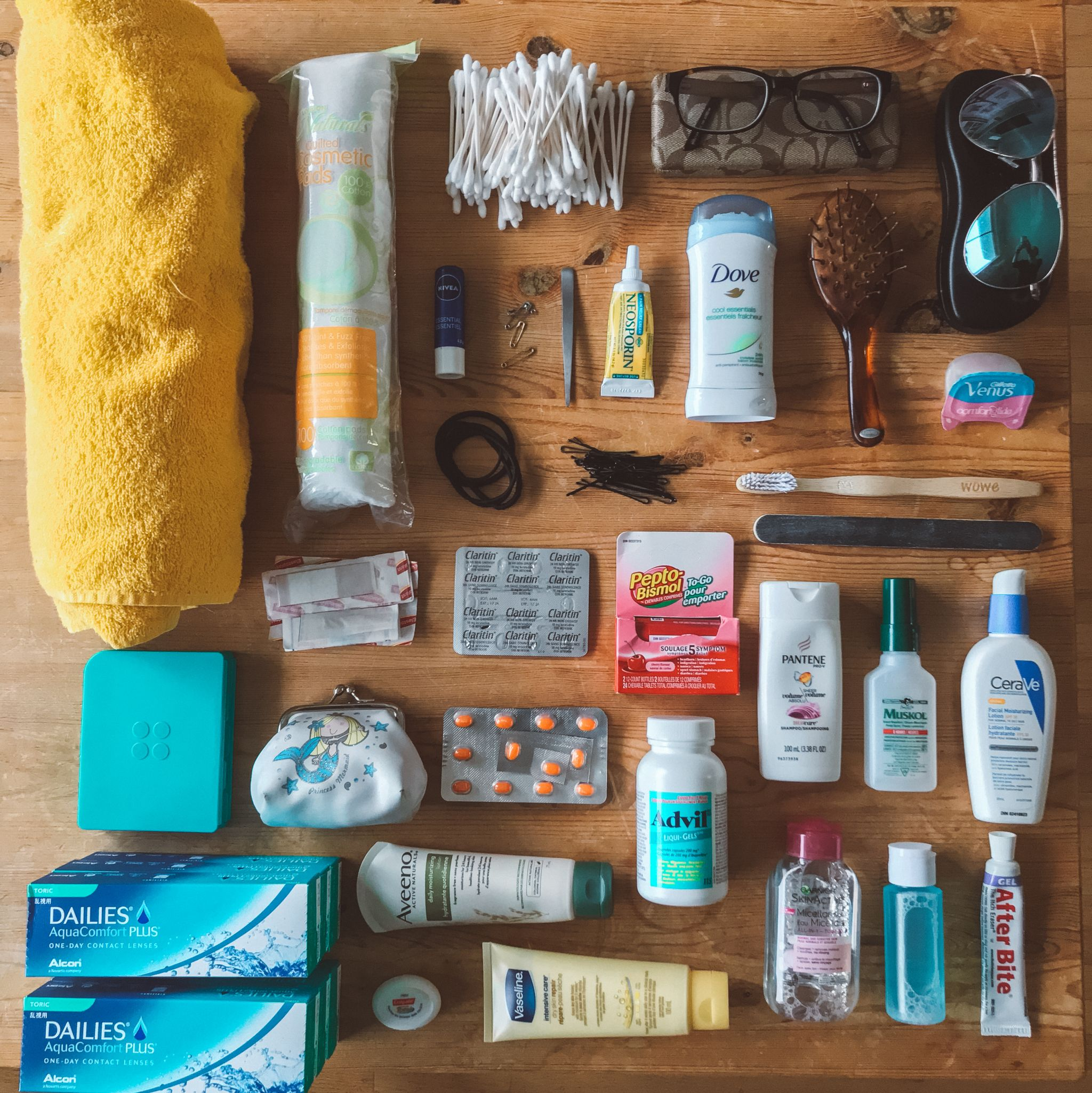 jana meerman packing flatlay toiletries